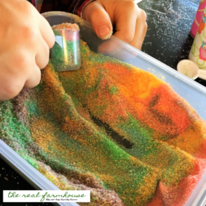 homemade edible play sand! All you need is pure cane sugar and feed coloring for loads of hands on fun!